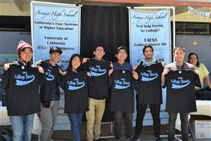 "Arroyo High School students receive ""AHS College Bound"" T-shirts during the inaugural ""Knights Charging Forward"" celebration"